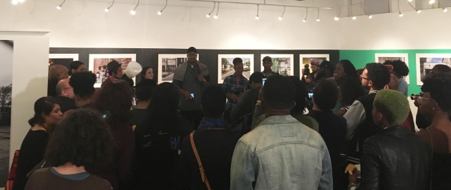 """Newark based artist and curator Akintola Hanif speaks at the opening of """"The 5 Wards"""" at City Without Walls Gallery (NWII Photo/Eric Valosin)"""